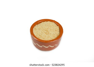 Small decorative bowl with minced cake on a white background