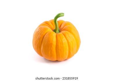 Small decorative orange pumpkin, isolated on white background
