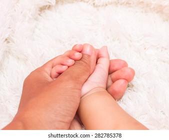 Small delicate little hand of newborn - close portrait