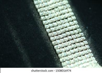 Small diamond rows bracelet on black background