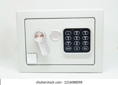 Small digital safe for home or office isolated on white background.