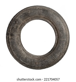 Small dirty old tire isolated over white