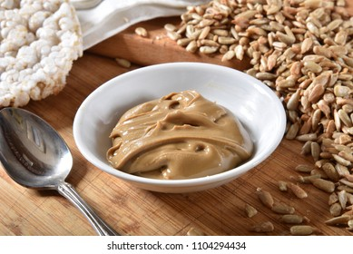 A small dish of fresh sunflower seed butter with rice cakes