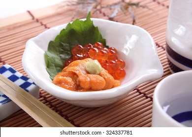 a small dish of Salmon roe, and sea urchin served as an appetizer before the main meal in a Japanese meal/ Sea urchin, and salmon roe