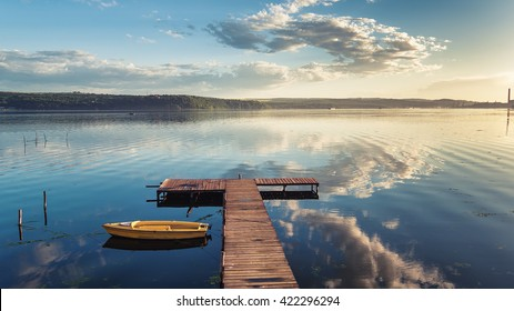 Small Dock and Boat at the lake, aerial view