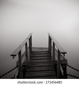 Small dock in foggy weather