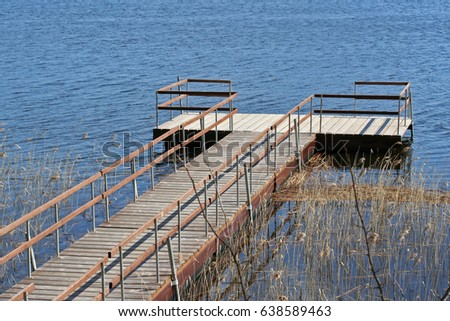 Small Dock Pontoon Boat On Lake Stock Photo (Edit Now
