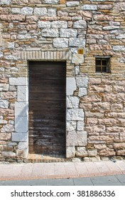 small door in the stone wall