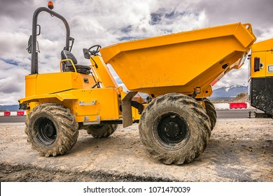 Small dumper in the works of a highway