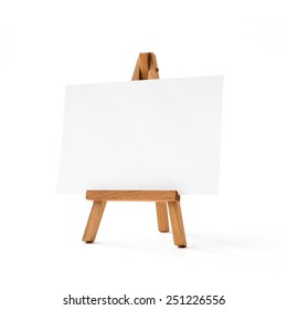 Small easel with white album sheet of paper