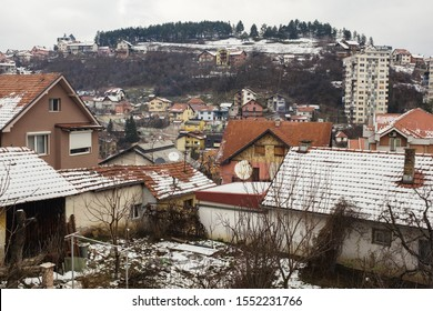 Small Eastern European town in winter time, house roofs partially covered in melting snow, Uzice, Serbia
