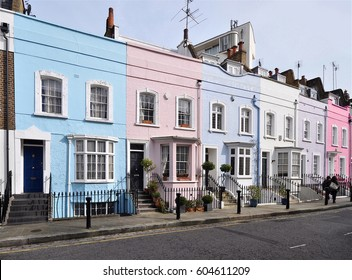 Small eighteenth century town houses with their brick facades now painted in various colours at Chelsea, London, UK.