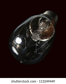 The small electric bulb is against a dark background