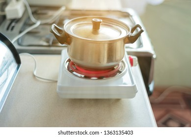 small electric stove for cooking. portable household appliances. food prepared in the home kitchen when there is no gas