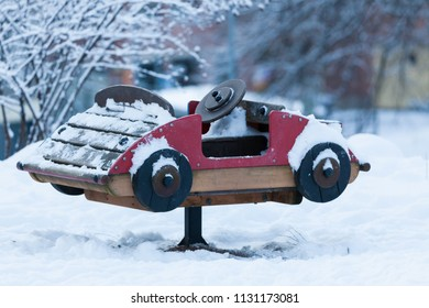Small empty playground car at winter