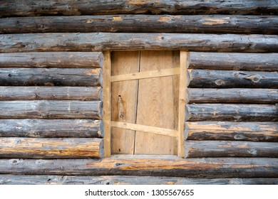 Small entrance door of old traditional wooden log house