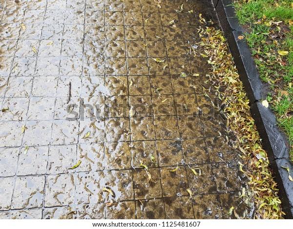 Small european street . rainy day, wet cobble stones. empty road in city center.Paving stone road