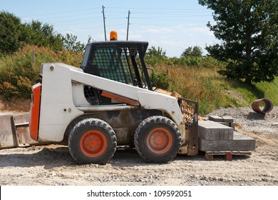 small excavator Bobcat at construction site