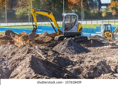 A small excavator on a construction site.