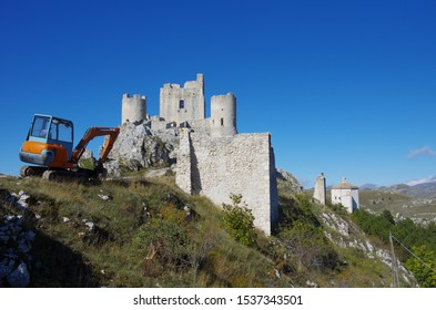 A small excavator that is used for consolidation and maintenance work near the Rocca Calascio castle after the post-earthquake in L'Aquila. Calascio, L'Aquila, Abruzzo, Italy