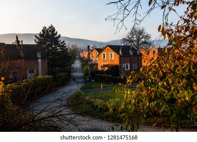 Small family houses from red brick, typical functionalist buildings with gardens in sunny autumn day in town Zlin, Czech republic.