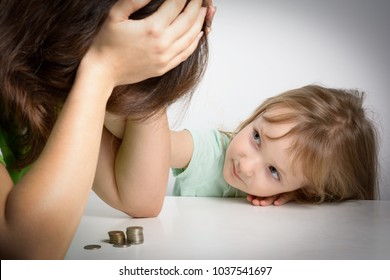 Small family. Single mother has financial problems. Her little daughter calms down sad mother.