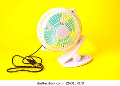 small fan on a yellow background