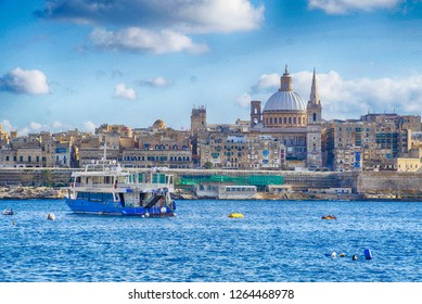 Small ferry crosses from Sliema to Valletta in  Malta