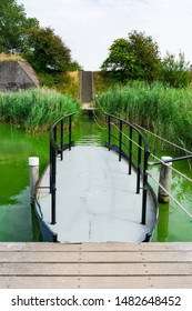 Small ferry in green water. Veere, The Netherlands