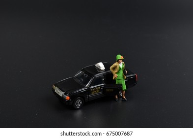 the small figure with the japan taxi