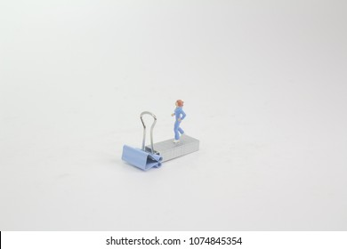 small figure with jogging woman on sport