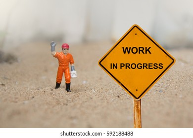 small figure of a man with Work in Progress message.
