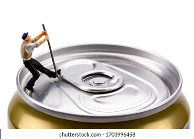 Small figure of Miniature people of worker that holding tool trying to open the can lid for drink and beverage concept