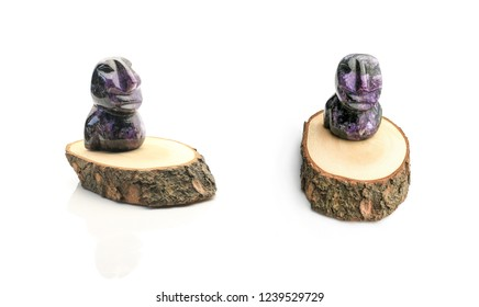 small figure of moai on a wooden stand. Souvenir product from an ornamental rare stone charoid (analogue of lapis lazuli)