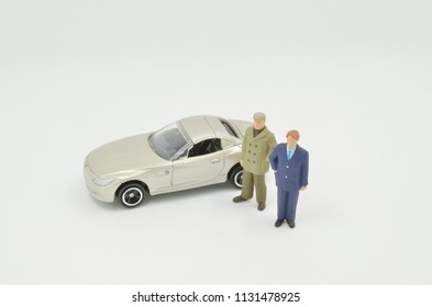 a small figures of business meeting with car