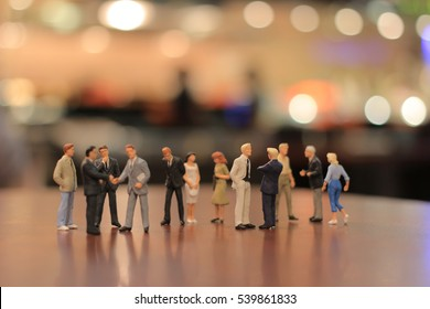 a small figures of business meeting event