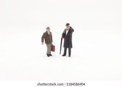 a small figures of  business men stand