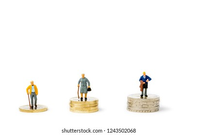 Small figurines and stacks of Euro coins on bright background. Economic inequality by gender. Inequality, starvation wages and income concept. Gender pay gap.