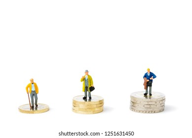 Small figurines and stacks of Euro coins on bright background. Inequality, starvation wages and income concept.