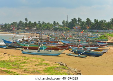 Small fisherman boats some where in Sri Lanka, tropical beach