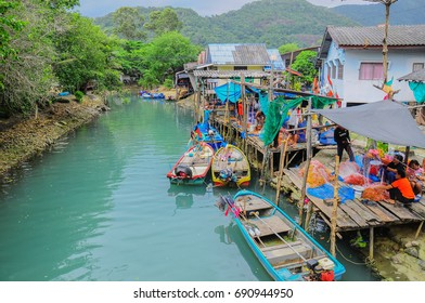 Small fishery village at koh Chang (elephant Island)- July 29, Fishermen are working for seafood from net which have been back from fishery on morning time on July 29, 2017 in Trat, Thailand