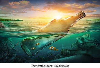 Small fishes in a bottle among ocean pollution. Environment concept