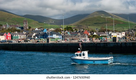 Small fishing boat coming into Dingle bay on the west coast of Ireland