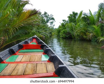 Small fishing boat cruising the river next to Kampot, Cambodia