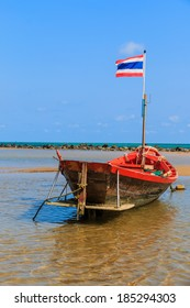 Small fishing boat moored along the beach,Thailand