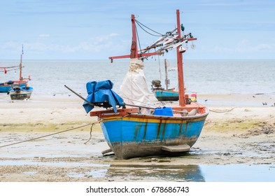 Small fishing boat on beach