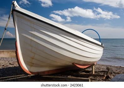 Small Fishing Boat on a Pebble Beach (Sidmouth Devon UK)