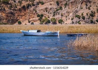Small fishing boat on River Dalyan between Dalyan village and Iztuzu Beach in Mugla Province of Turkey