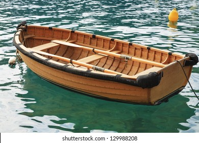 Small fishing boat on the sea water in a secluded bay