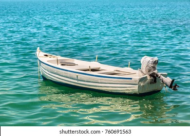 Small fishing boat on the sea in a summer day